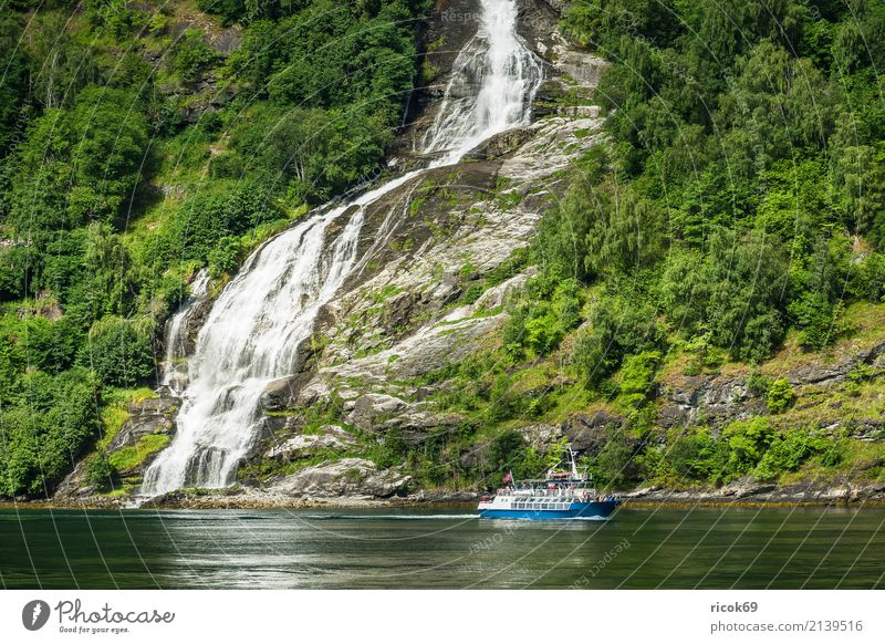 View of the Geirangerfjord in Norway Vacation & Travel Tourism Cruise Mountain Nature Landscape Water Clouds Tree Forest Rock Fjord Waterfall Tourist Attraction