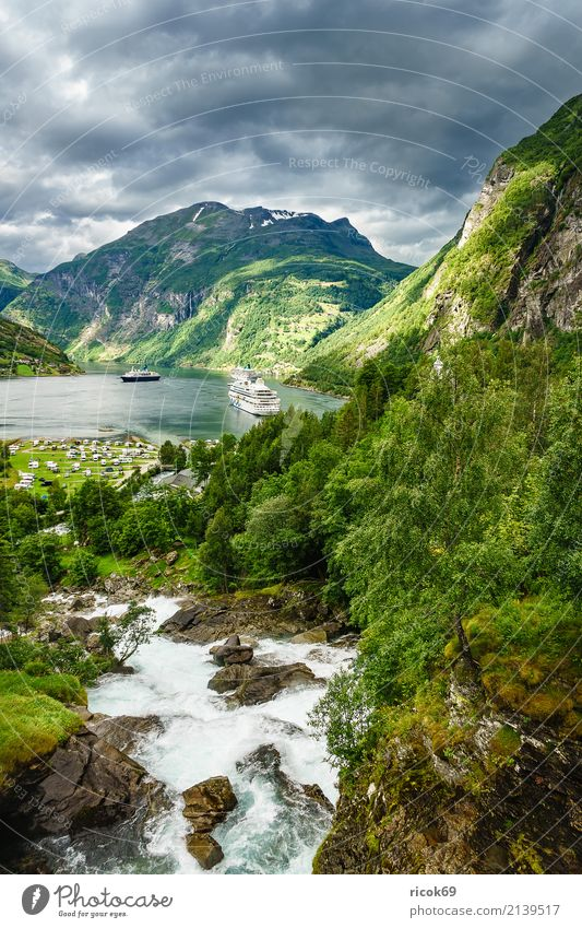 View of the Geirangerfjord in Norway Relaxation Vacation & Travel Tourism Cruise Mountain Nature Landscape Water Clouds Rock Fjord River Tourist Attraction