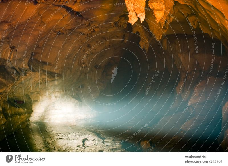 Underground Earth Summer Cave Stalactie cave Stalactite Guilin China Old Dream Cold Shadow Beam of light Blue Orange Long exposure Floodlight Colour photo