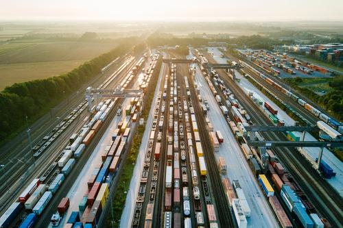 Freight trains and freight containers in a container terminal Economy Industry Trade Logistics Business Technology Advancement Future Transport