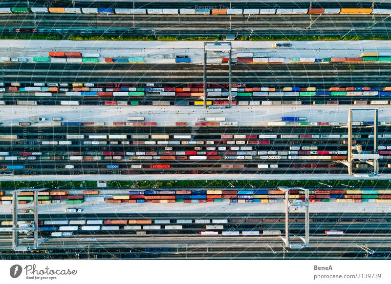 Freight trains and colorful containers in a logistics station Economy Industry Trade Logistics Business Technology Advancement Future Transport
