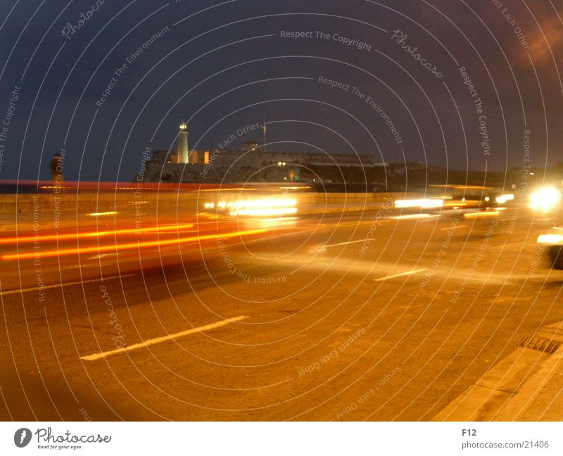 Cuba Malecon El Malecón Night Lighthouse Motion blur Long exposure Dark Ocean Brake light Orange Car Sky Floodlight