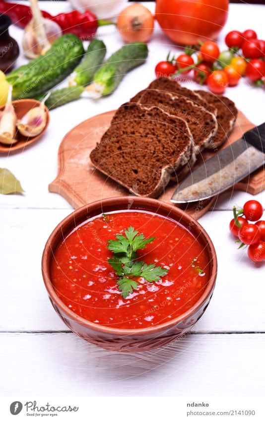 Soup gazpacho in a brown plate Green White Red Natural Wood Nutrition Fresh Table Herbs and spices Kitchen Delicious Vegetable Harvest Tradition Fat Bread