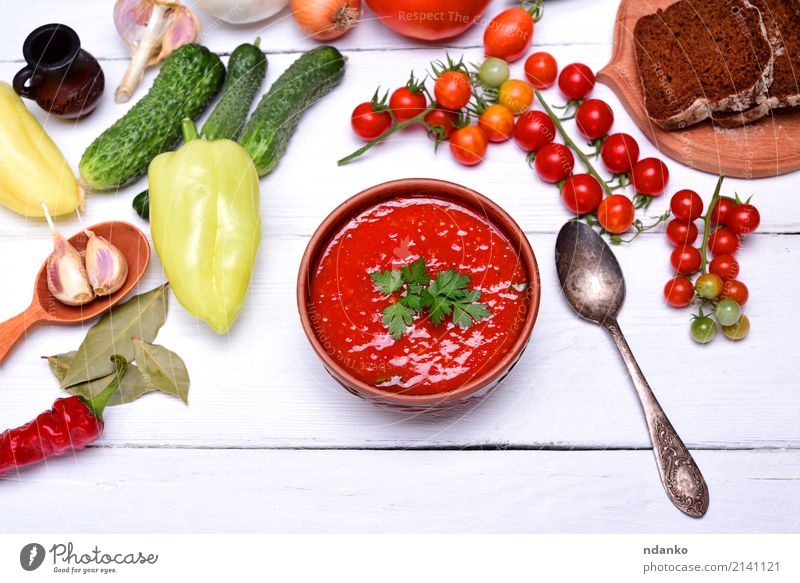Soup gazpacho in a brown ceramic plate Vegetable Bread Stew Herbs and spices Nutrition Lunch Dinner Vegetarian diet Diet Plate Spoon Summer Table Kitchen Wood