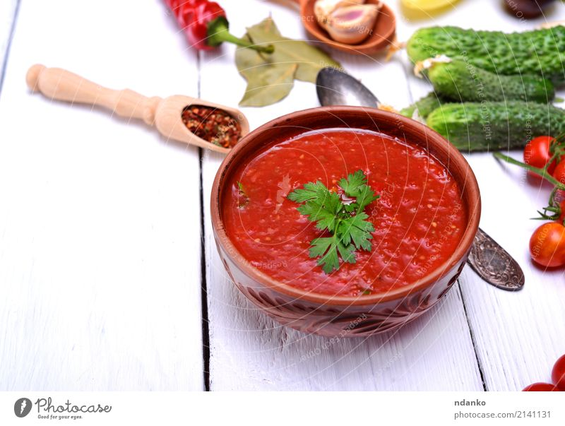 Cold gazpacho soup Vegetable Soup Stew Herbs and spices Nutrition Lunch Dinner Vegetarian diet Diet Plate Spoon Table Kitchen Wood Fat Fresh Delicious Natural