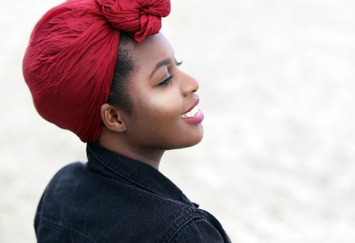 arabella Feminine Woman Adults 1 Human being Beach Jacket Headscarf Observe Smiling Laughter Looking Friendliness Happiness Beautiful Emotions Joy