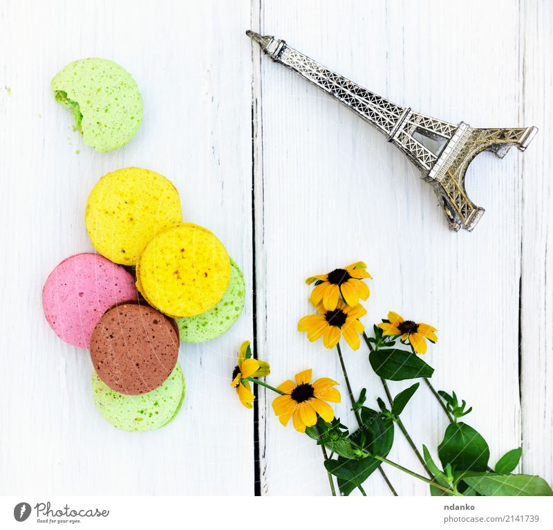 Multi-colored pastries macarons Dessert Candy Gastronomy Flower Bright Delicious Brown Yellow Green Pink White Tradition colorful background Macaron sweet cake
