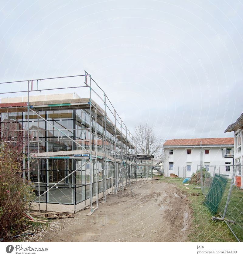 construction site Sky House (Residential Structure) Manmade structures Building Architecture Construction site Facade Window Scaffold Modern New Colour photo