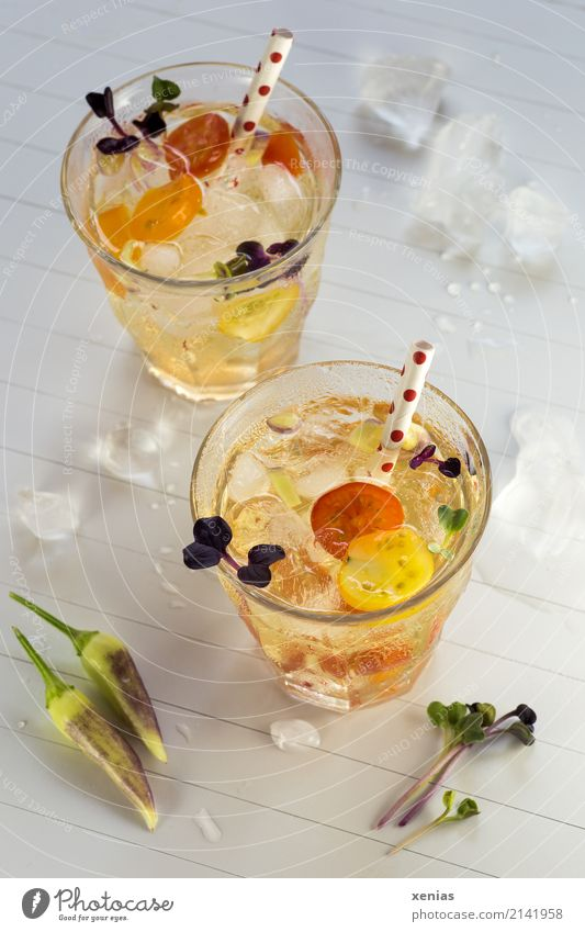 Two glasses of spicy iced aromatic water with tomato, chilli and red radish Vegetable Tomato Radish Chili Beverage Cold drink Drinking water Ice cube Glass