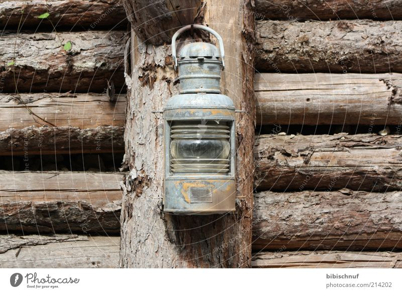 old rusty lantern at the wooden fence Wood Brown Colour photo Exterior shot Deserted Day Front view Lantern ship's lantern Wooden wall Joist Gray Old Shabby