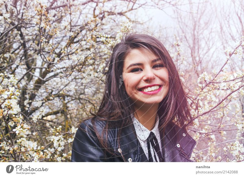 Young woman smiling at springtime Human being Nature Youth (Young adults) Beautiful Tree Flower Joy 18 - 30 years Adults Lifestyle Spring Feminine Style