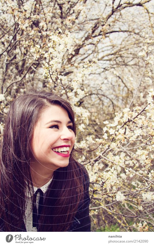 Young happy woman posing close to a blossoming tree Human being Nature Youth (Young adults) Young woman Beautiful Tree Flower Joy 18 - 30 years Adults Life
