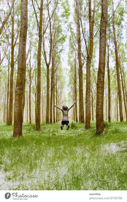 Young woman jumping in the middle of a forest Human being Nature Vacation & Travel Youth (Young adults) Green Tree Landscape Far-off places Forest 18 - 30 years
