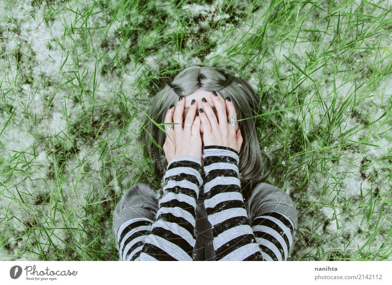 Young woman covering her face with her hands Human being Nature Youth (Young adults) Green 18 - 30 years Black Adults Environment Spring Natural Feminine Grass