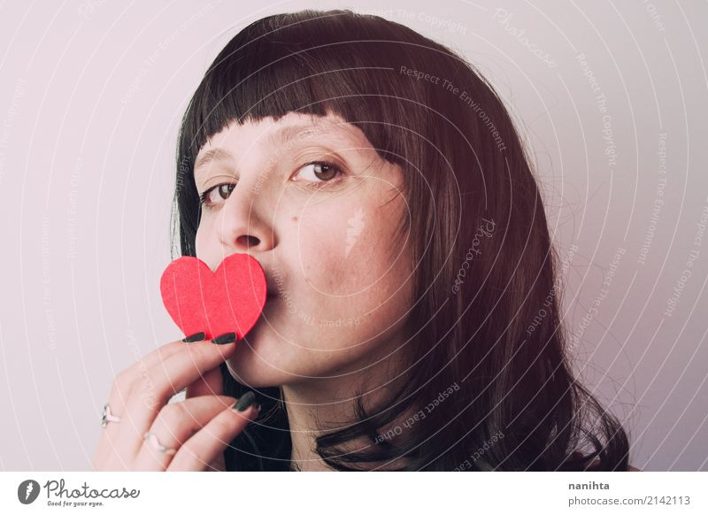 Young woman kissing a heart Human being Youth (Young adults) Beautiful Red 18 - 30 years Black Adults Love Feminine Happy Hair and hairstyles