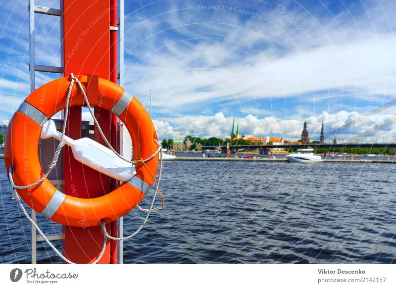 Life ring in the background of the city of Riga Vacation & Travel Tourism Summer Beach Ocean Winter Landscape Coast Harbour Transport Watercraft Ring Blue Red