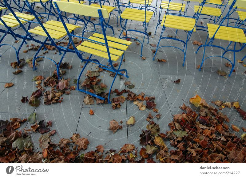 off-season Tourism Trip Autumn Leaf Emotions Moody Beer garden Empty Calm Chair Deserted Yellow Metal Wood Gastronomy Stone floor
