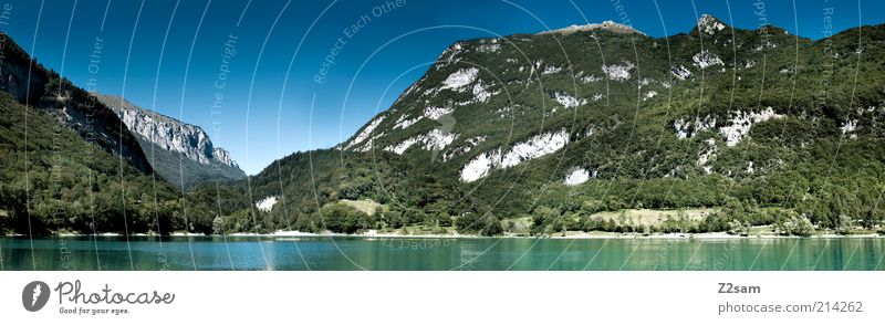 Lago di Tenno Environment Nature Landscape Cloudless sky Summer Plant Tree Mountain Lake Relaxation Vacation & Travel Illuminate Esthetic Far-off places