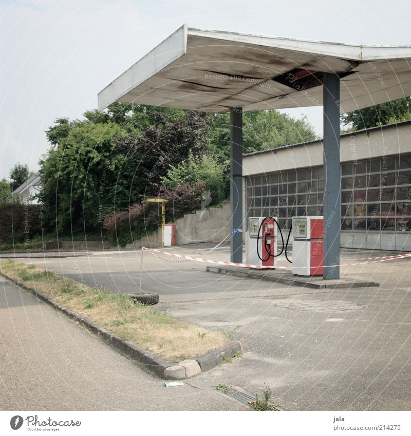 everything super! Sky Tree Bushes Industrial plant Manmade structures Building Architecture Old Esthetic Petrol station Petrol pump Colour photo Exterior shot