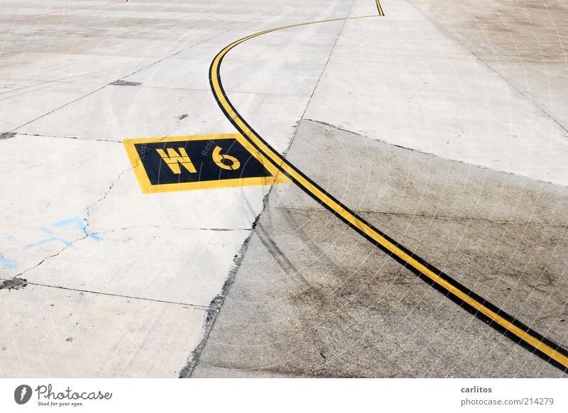 Vacation & Travel Black Yellow Gray Line Wait Concrete Signs and labeling Digits and numbers Letters (alphabet) Airport Traffic infrastructure 6 Majorca Arch