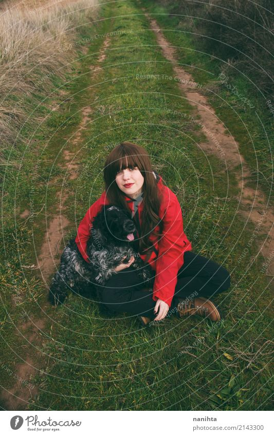Young woman with her dog in a green rural path Human being Nature Dog Youth (Young adults) Green Red Animal 18 - 30 years Black Adults Environment Lifestyle