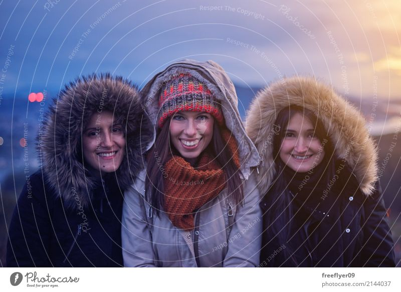 Three young women smiling at sunset in winter Human being Sky Vacation & Travel Youth (Young adults) Young woman Winter 18 - 30 years Adults Environment