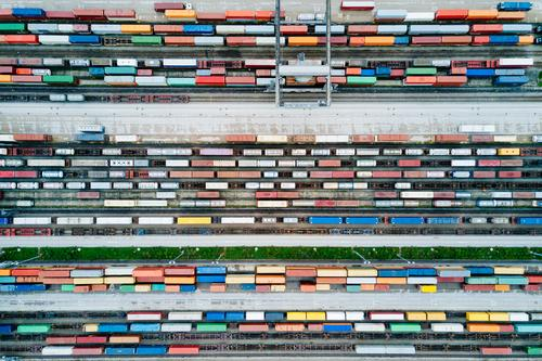 Freight trains and freight containers in a container terminal Workplace Economy Industry Trade Logistics Business Machinery Technology crane Transport