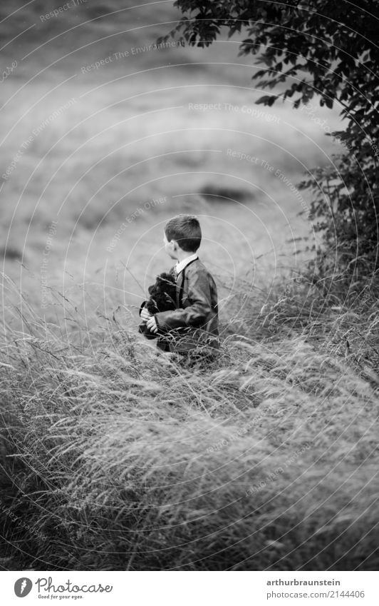 Boy with teddy bear in high grass Leisure and hobbies Children's game Trip Human being Masculine Boy (child) Brother Family & Relations Infancy Life 1