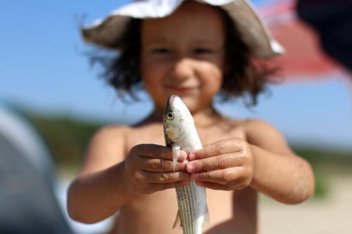 my fish Human being Child Vacation & Travel Hand Joy Life Funny Emotions Playing Leisure and hobbies Infancy Happiness Study Fish Childhood memory Protection
