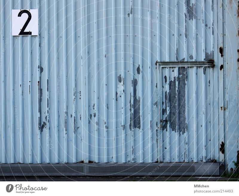 2 Building Blue Hall Tin Door Entrance Signs and labeling signage Digits and numbers Gray Hangar Colour photo Exterior shot Deserted Copy Space left