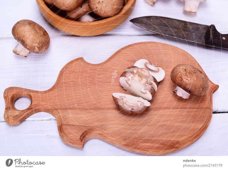 Chopped fresh mushrooms Vegetable Vegetarian diet Bowl Knives Kitchen Wood Fresh Brown White Champignon Mushroom board knife Top background food Edible Raw