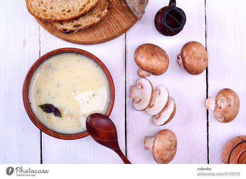 mushroom soup with champignons Vegetable Bread Soup Stew Dinner Vegetarian diet Diet Plate Spoon Wood Fat Fresh Hot Above Brown White Slice Vegan diet Mushroom