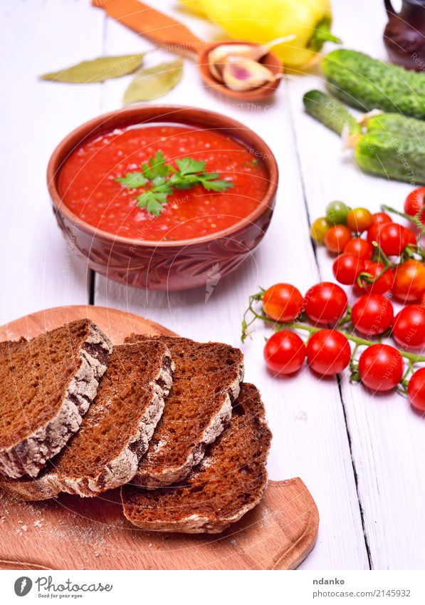 Sliced rye bread on a kitchen board Vegetable Bread Soup Stew Herbs and spices Nutrition Lunch Dinner Vegetarian diet Diet Plate Table Kitchen Wood Fat Fresh