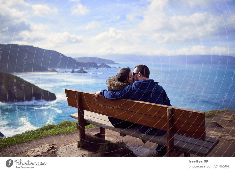 "A couple kissing in ""the best bench in the world"" Human being Woman Sky Nature Vacation & Travel Man Landscape Ocean Clouds Winter Beach Mountain Adults"