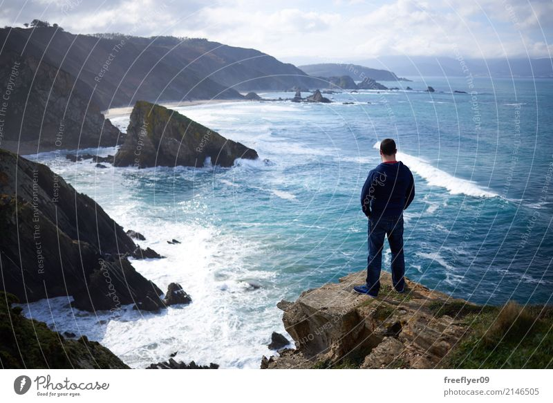 Man contemplating the ocean from a cliff Human being Sky Nature Vacation & Travel Youth (Young adults) Water Landscape Loneliness Clouds Far-off places Adults