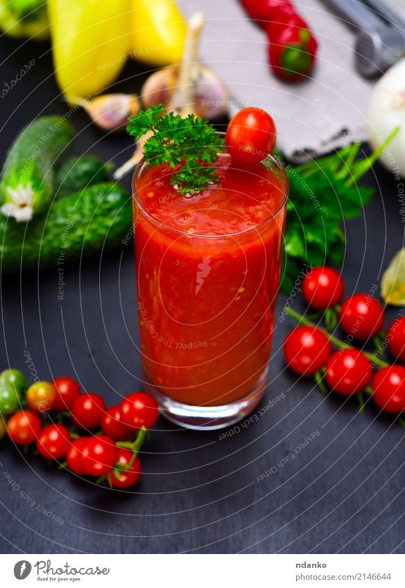 Freshly made juice from red tomato Vegetable Herbs and spices Vegetarian diet Diet Juice Glass Kitchen Wood Green Red Black Tomato Cherry pepper background