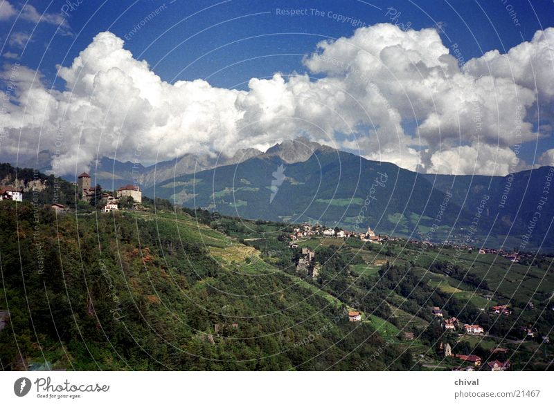 Tyrol village Village South Tyrol Clouds Panorama (View) Cumulus Mountain Alps Thunder and lightning Castle Large