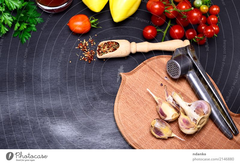 Fresh vegetables and garlic Food Vegetable Herbs and spices Vegetarian diet Diet Kitchen Wood Green Red Black Tomato Cherry pepper background Ingredients