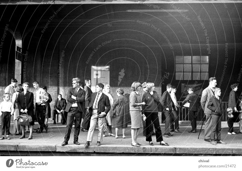 On the platform Platform Railroad tracks Endurance Human being Passenger Retro Group Wait Train station Patient