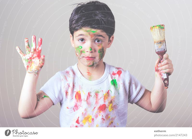 boy with painted face and T-shirt painting Human being Child Joy Lifestyle Funny Boy (child) Playing Happy Masculine Dirty Infancy To enjoy Happiness Adventure