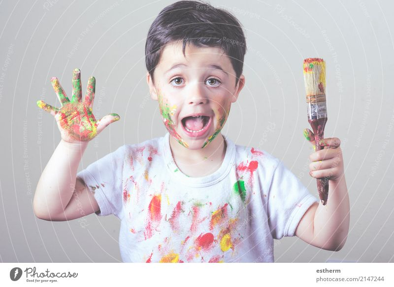 boy with painted face and T-shirt painting Lifestyle Joy Children's game Education Kindergarten School Human being Masculine Toddler Infancy 1 3 - 8 years