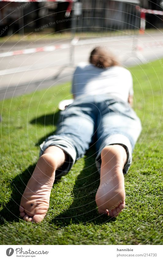 relaxation Human being Masculine Young man Youth (Young adults) 1 18 - 30 years Adults Street Contentment Serene Calm Vienna Lie Relaxation Barefoot Meadow