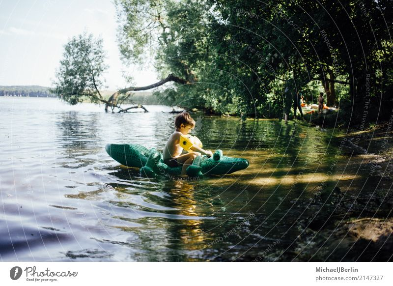 little boy in the water with a crocodile air mattress Joy Swimming & Bathing Masculine Toddler Boy (child) 1 Human being 3 - 8 years Child Infancy Water Summer