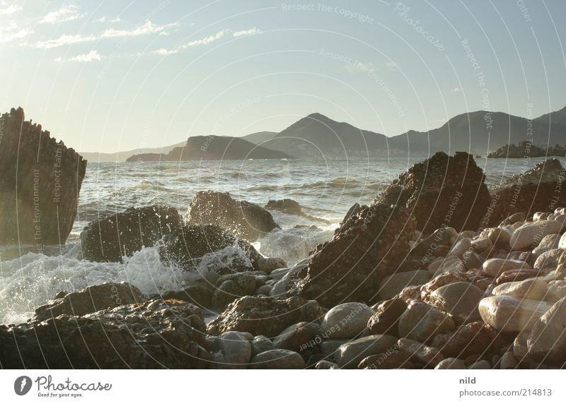 Sky Nature Water Summer Beach Vacation & Travel Ocean Calm Freedom Mountain Landscape Environment Stone Coast Waves Rock