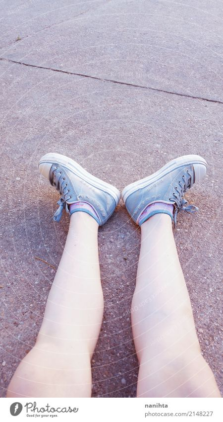 Teen girl legs wearing jeans sneakers Human being Feminine Young woman Youth (Young adults) Legs Feet 18 - 30 years Adults Stockings Sneakers Stone Sit Wait