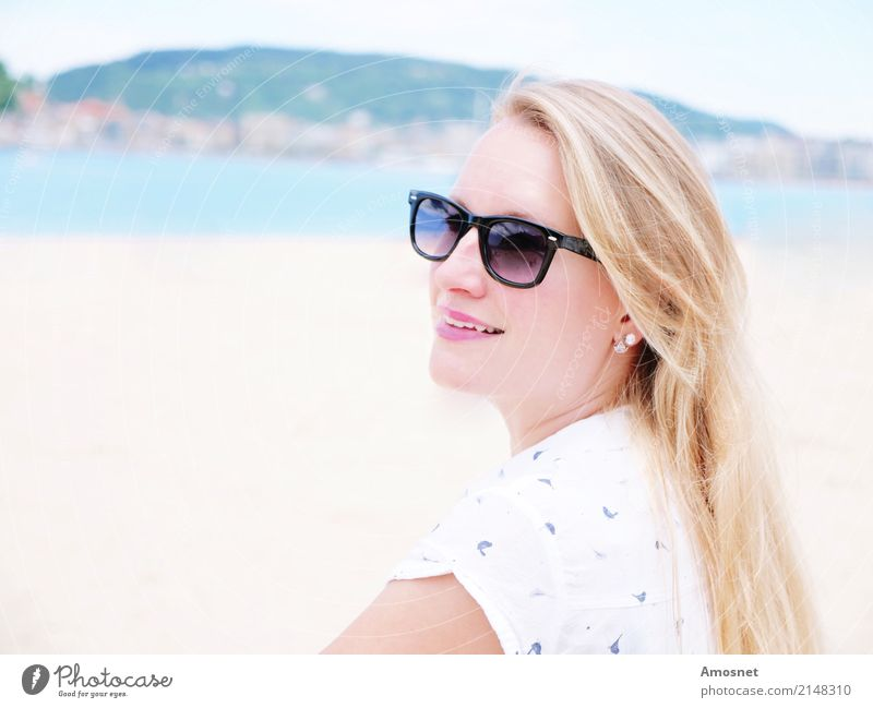 Blonde young woman on the beach with sunglasses Lifestyle Relaxation Vacation & Travel Tourism Beach Human being Feminine Woman Adults 1 18 - 30 years