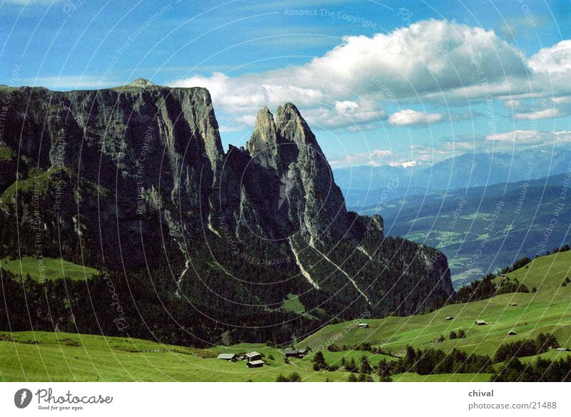 Alpe di Siusi South Tyrol Seiser Alm High plain Meadow Clouds Grainy Mountain Alps Santer Point Rock Vantage point Far-off places