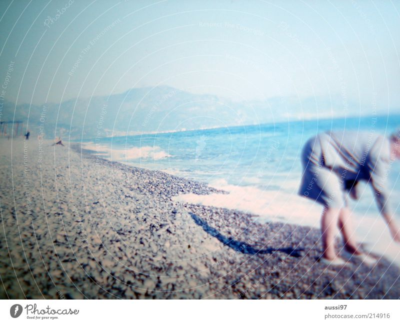 Sky Beach Far-off places Mountain Coast Search Hill Lady Collection Surf Costume Pebble Human being Clothing Stoop Flotsam and jetsam