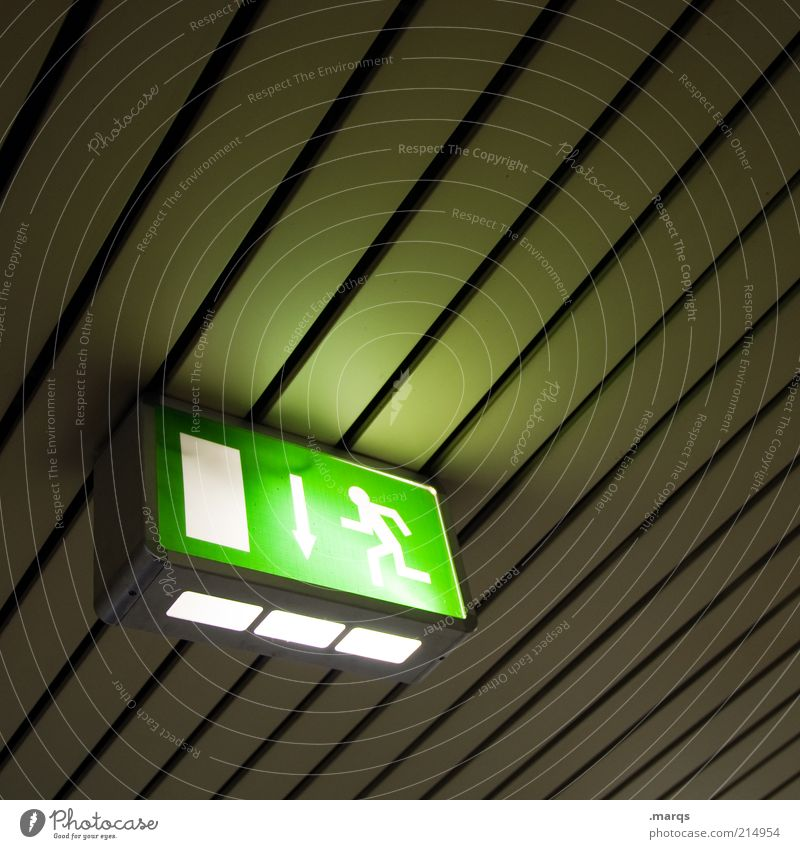 escape Design Ceiling Emergency exit Sign Signage Warning sign Line Running Illuminate Dark Simple Above Perspective Flee Pictogram Colour photo Interior shot