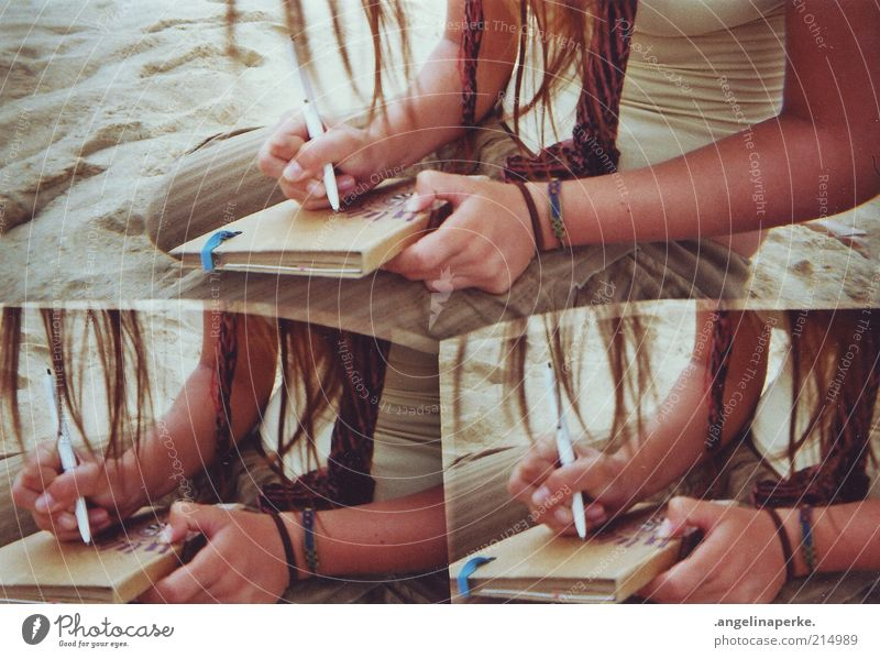 Young woman Sand Arm Book Write Media Brunette Irritation Long-haired Section of image Bracelet Human being